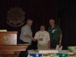 Larry gives Ken and Ruth Parrish an award