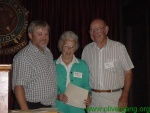 Larry presents an award to John and Betty Faust